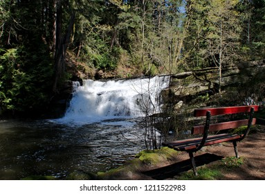 Great capture featuring Millstone River in Bowen Park, Nanaimo cascading over the bottom fall enhanced by sunny condition and featuring a wonderful bench to take in the full display unfolding.
