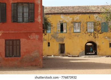 Great colored walls with windows of ancient houses of goree island in senegal