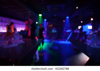 great colorful crowd shot in a nightclub.