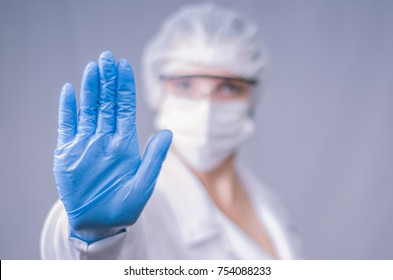 Great concept of infection, contamination, doctor making stop sign with his hand.