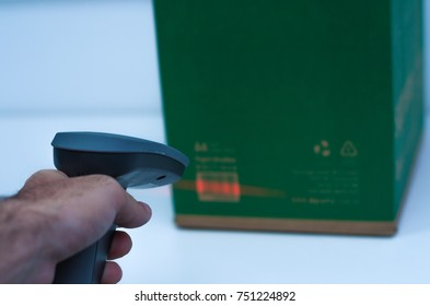 Great concept of traceability, ERP system, hand crawling product barcode and packaging. The man gets on the hip scanner in operations directed on printed barcode. Warehouse scene. Shallow DOF!