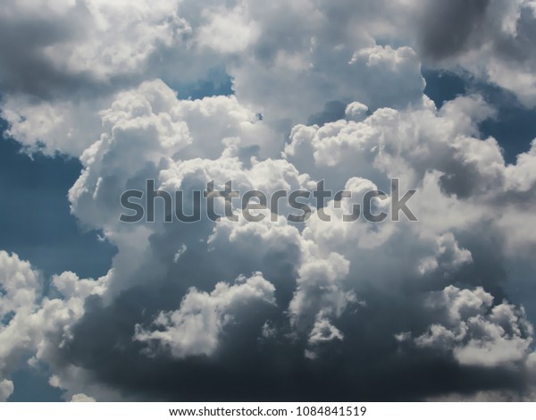 great cumulonimbus cloud with shades of colors ranging from white to gray, with well defined details, rising to the sky looking like an explosion, sao paulo, brazil