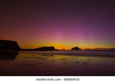 A great display of Aurora Borealis captured on a beach.