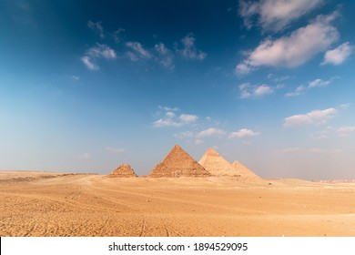 Great Egyptian pyramids of Giza with blue cloudy sky