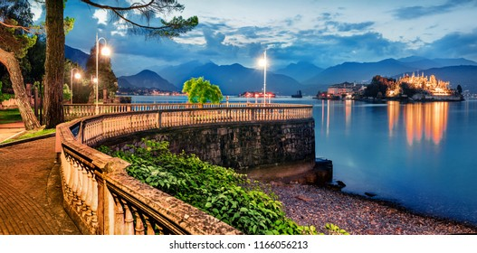 Great evening cityscape of Stresa town. Picturesque summer susnset on Maggiore lake with Bella island on background, Province of Verbano-Cusio-Ossola, Italy, Europe. Traveling concept background.