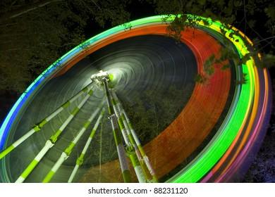 Great ferris wheel in a deep night fun fair.