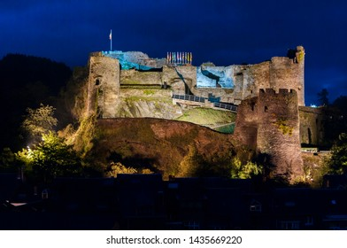 The great fortress of La Roche-en-Ardenne, Ardennes, Belgium, is illuminated at night.