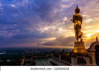 """Great Golden Buddha statue at the""""Wat Phra That Kao Noi"""" , Nan province, Thailand  with sky  Twilight time  ."""