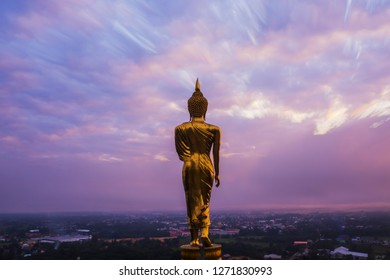"Great Golden Buddha statue at the""Wat Phra That Kao Noi"" , Nan province, Thailand  with sky  Twilight time  ."
