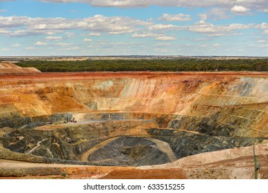Great goldmine in western Australia. Large dump trucks bring the gold-bearing rock to the surface. Westonia, Western Australia, Australia