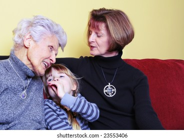 Great grand-daughter shares a secret with great grandmother