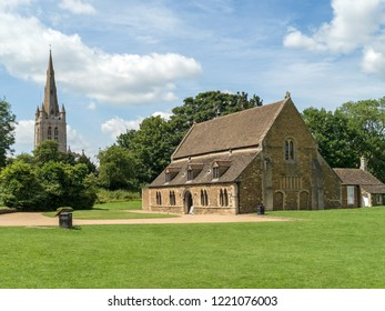 The Great Hall of Oakham Castle with the tower of All Saints Church behind, Oakham, Rutland, England, UK.