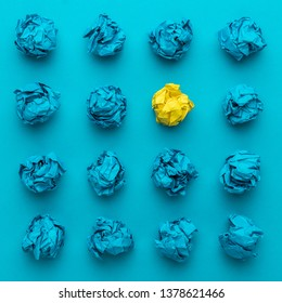 great idea concept with crumpled office paper. top view of great business idea concept over blue background. creative solution during brainstorming session concept