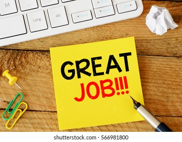 Great job / Great job sticker with marketing plan inscription over computer keyboard