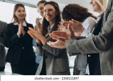 Great job! Successful business team is clapping their hands in modern workstation, celebrating the performance of new product