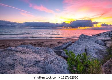 Great Lakes Sunrise Landscape. Sunrise horizon over the rocky coast of Lake Huron in the small coastal town of Lexington, Michigan.