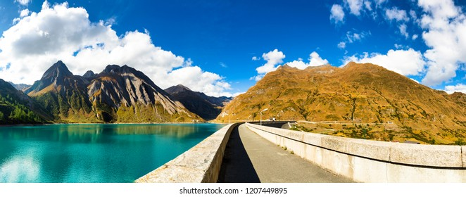 great landscape seen from dam of Morasco Lake with mountains and blue sky in background in a autumn day, Formazza valley - Piedmont, Italy, Europe