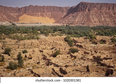 The great landscape view of a ruin city of Al Ula with a big mountain as background. Soft focus due to desert dust effect