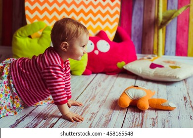 great little kid playing with soft kitty