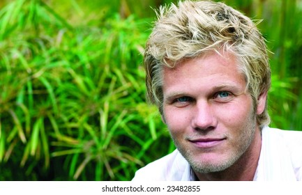 Great looking blond surfer guy.  Room for copy.