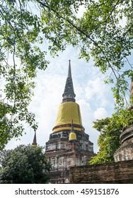 Great main pagoda  under the noon sun light at Wat Yai Chaimongkhon, Ayutthaya Province, Thailand, public domain. Ancient concept