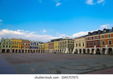 Great Market Square and row of old colourful buildings in the center of Zamosc city (The Pearl of Renaissance, UNESCO World Heritage), Poland
