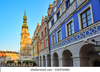 Great Market Square, Zamosc, Poland - September, 21, 2018: Zamosc town hall on Great Market Square. Large landmark city square in historical centre of town, flanked by arcaded buildings housing shops