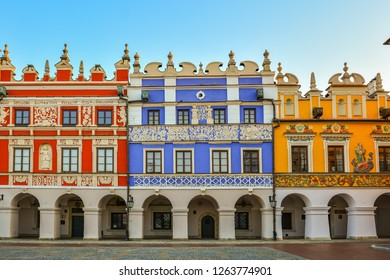 Great Market Square, Zamosc, Poland - September, 21, 2018: Multicolored facades of historic buildings on Great Market Square in Zamosc. Large landmark city square in historical  centre of town.