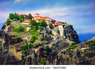 Great Meteoron Monastery. Beautiful scenic view, ancient traditional greek building on the top of huge stone pillar and sunset sky in Meteora, Eastern Orthodox Church, Pindos, Thessaly, Greece, Europe