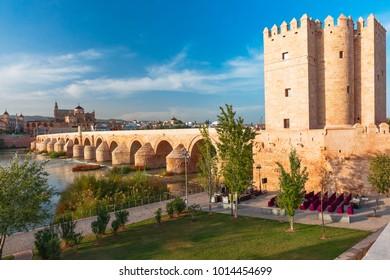 Great Mosque Mezquita - Catedral de Cordoba, Roman bridge across Guadalquivir river, old mill and Torre de Calahorra in the morning, Cordoba, Andalusia, Spain