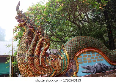 Great naga ladder. At Wat Phra That Doi Suthep temple in Chiang Mai, Thailand. foggy rainy day. Age more than four hundred years old, there are 173 steps. Thai style dragon.