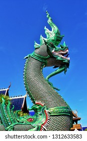 Great naga statue, King of nagas,Serpent. Green naga statue with with sky background. Chiang Mai. Thailand.