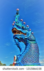 Great naga statue, King of nagas,Serpent. Blue naga statue with sky background. Naga statue at Banden temple, Chiang Mai. Thailand.