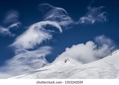 Great nature mountain range. Amazing perspective of caucasian snow mountain or volcano Elbrus with blue sky background. Elbrus landscape view - the highest peak of Russia and Europe