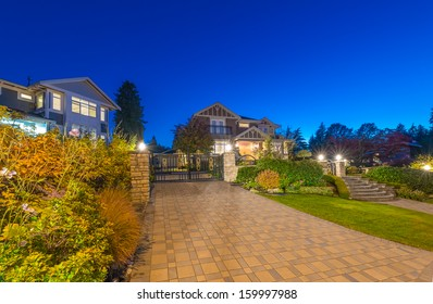 Great neighborhood. Luxury houses with nicely  paved doorway at dusk, night time in suburbs of Vancouver, Canada.
