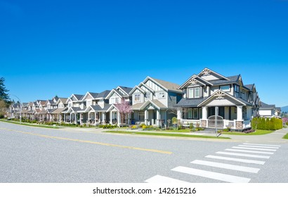 Great neighborhood. Row of the houses, homes on empty street in suburbs of Vancouver, Canada.
