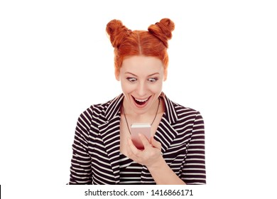 Great news. Closeup portrait cut out of beautiful Happy woman in her 30s  looking at smartphone super excited wearing striped black white jacket with 2 buns up hairdo isolated on white background wall