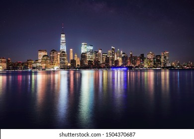 Great night view of the famous skyline of Manhattan downtown district with many skyscrapers, NYC USA