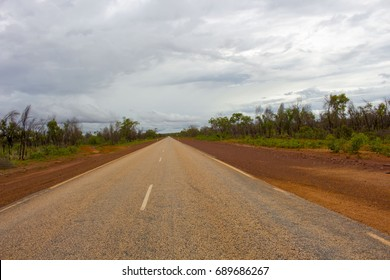 Great Northern Highway ,a sealed road with  length of 3,200 kilometres (2,000 miles)  the longest highway in Australia , between Broome and Derby , Western  Australia on a cloudy morning in summer.