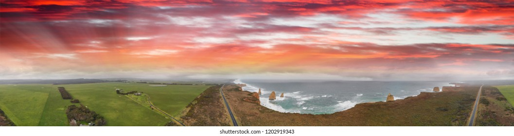 The Great Ocean Road along Twelve Apostles, Australia. Panoramic aerial view on a stormy day at sunset.