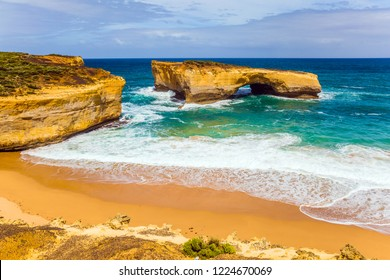 The Great Ocean Road of Australia. White surf foam and azure waves. Fantastically picturesque Pacific coast of Australia. The concept of exotic, active and photo-tourism