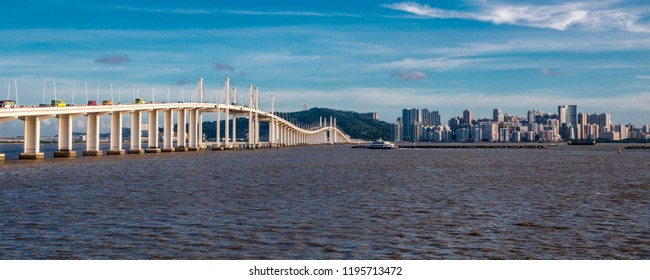 Great panoramic view on a sunny day of the Macau Friendship Bridge or Amizade Bridge which connects the peninsula and Taipa Island across the Zhujiang River estuary where most of the casinos are.