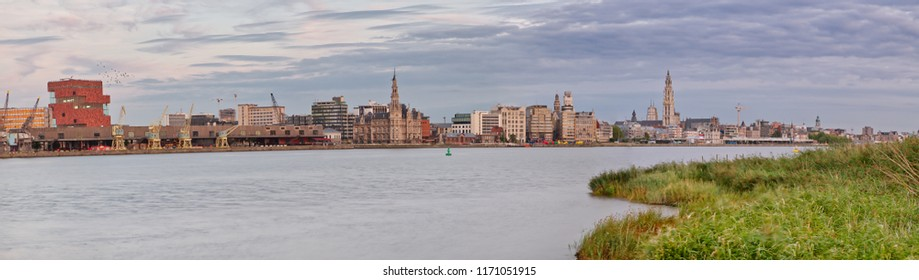 A great panoramic view over the city of Antwerp. This cityscapes covers the beautiful cathedral, the 'MAS', 'het steen', ... This is an original view from the city of diamonds. The river Scheldt flows