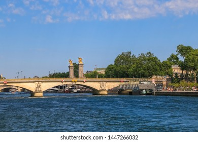 Great panoramic view of the Pont des Invalides on a nice sunny day with blue sky. Its piers are adorned with military trophy sculptures and it is the lowest bridge traversing the Seine in Paris.