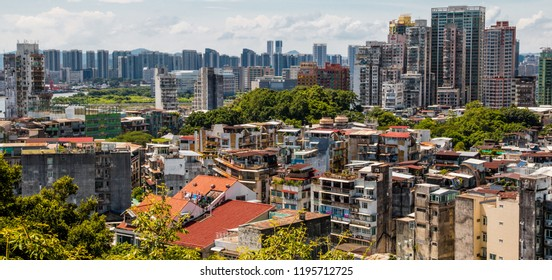 Great panoramic view of the urban landscape of Macau, one of the most densely populated territory worldwide. The idiosyncratic residential buildings tell a history of cohabitation between East & West.