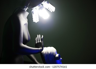 Great photo of black mannequin with lamp head, holding the white female statue head with camera eye. Awesome choise for different art projects, colages, posters