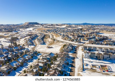 A great photo illustrating Denver urban sprawl and the Colorado housing boom as it continues even in the winter snow