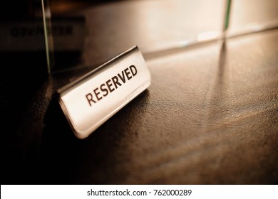 """A great photography of the """"Reserved"""" sign on the table, in the restaurant."""