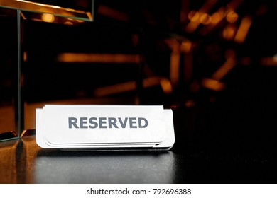 """A great photography of the """"Reserved"""" sign on the table"""