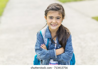 Great Portrait Of School Pupil Outside Classroom Carrying Bags